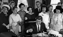 AAUW members with President John F. Kennedy as he signs the Equal Pay Act into law on June 10, 1963.
