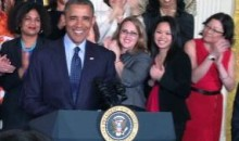 AAUW staff stand behind former President Barack Obama on the 50th anniversary of the Equal Pay Act