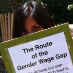 A green board with a CSUN flyer on the college wage gap.