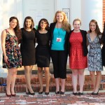 Group of college women standing outside a university building