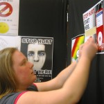 Woman putting up posters