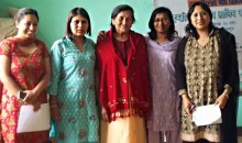 A group of Nepalese women smiling.