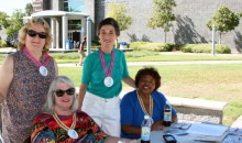 Four members of the AAUW La Palma-Cerritos (CA) Branch tabling and spreading the word about AAUW at Cerritos College.