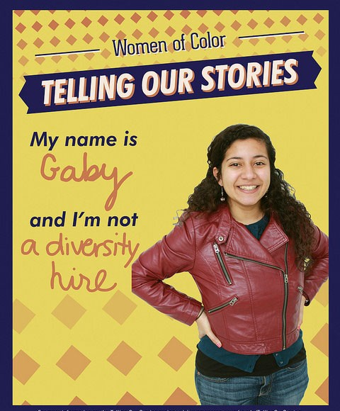 """A poster that has a student's photo and says, """"My name is Gaby, and I'm not a diversity hire."""""""