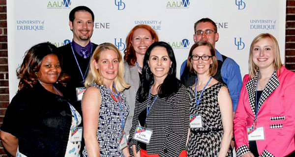 The 2014-15 CAP team from Dubuque standing together in front of an AAUW banner