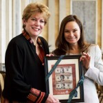 U.S. Treasurer Rosie Rios (right) and AAUW CEO Linda Hallman display AAUW's suggested images for the new $10 bill.