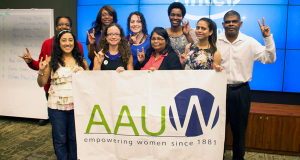 The USF students with an AAUW banner