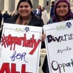 AAUW employees hold protest signs at the Supreme Court