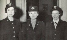 Black and white photo of women standing in their Marine Corps uniforms.