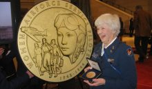 Women Airforce Service Pilot (WASP) Elaine Harmon holding her Congressional Gold Medal in 2010