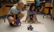 Tech Trek campers examine a robot at a 2016 New Mexico Tech Trek camp sponsored by Lockheed Martin.