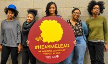 Five members of the University of the District of Columbia's AAUW Campus Action Project team stand with their leadership project poster for #HEARMELEAD.
