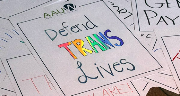 AAUW staff protested with signs at the Trump White House urging against efforts to roll back trans rights.