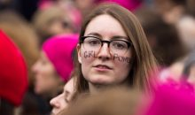 "Women's March on Washington, January 2017. Woman with ""Girl Power"" written on her face. Copyright David Hathcox for AAUW."