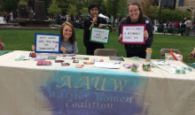 Wayne State University Students tabling with positive messaging about women and feminism