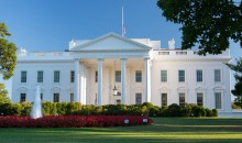 U.S. Flag flies at half-staff at the White House and all Federal facilities due to the Navy Yard shooting on September 16, 2013.