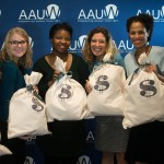 AAUW staff hold burlap sacks representing the increased salary that can be earned after attending an AAUW salary negotiation workshop.