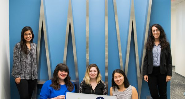AAUW Interns pose with the AAUW sign