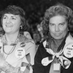 AAUW members are the National Women's Conference in 1977