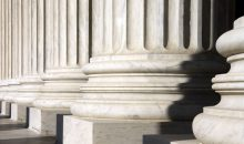 Close up photo of columns at the U.S. Supreme Court building in Washington, DC. Photo by Ben Balter. Flickr.
