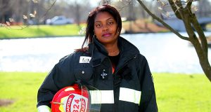 AAUW Career Development Grantee and fire caption, Carolyn Moore, stands in her gear. Moore is the only African-American woman commissioned officer serving in the the St. Louis Fire Department.